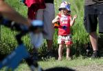 Shaelyn Verplank, 2, of Colorado Springs, cheers as her mom's category starts the Beti Bike Bash mountain bike race.