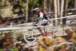 A junior racer warping through the woods.