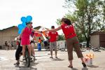 The New Belgium Joyride checkpoint required one teamate to pedal and steer a 20 inch bike while the other teamate rode and collected two ribbons to complete.