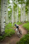 Chloe Woodruff descends through tall aspens.